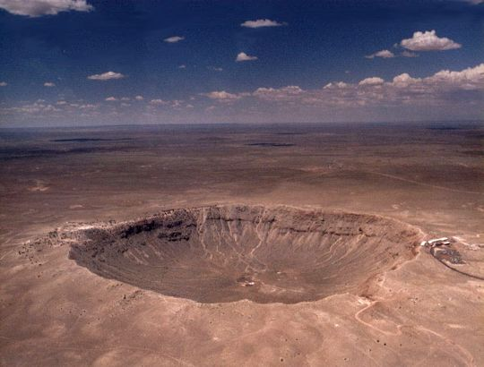 Near Winslow, AZ. About 1.2 km across and .2 km deep. An impact about 25,000 years ago. The meteor that caused it is estimated at 50 meters diameter which would have weighed about 300,000 tons. Photo by Brad Snowder.