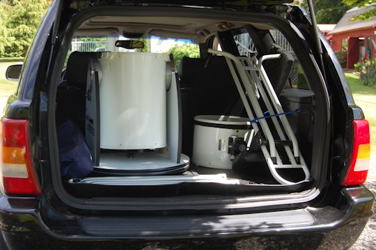 Plenty of room for the 12 inch, chair, and other gear in a Jeep Grand Cherokee.