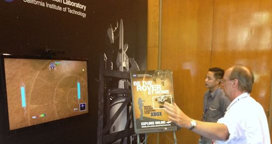 Yours truly, the author, trying his hand at landing the Curiosity Rover. Aug 5, 2012, JPL. Photo by someone else.