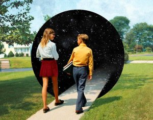 1970S Teen Boy And Girl Walking Down Suburban Street Carrying School Books