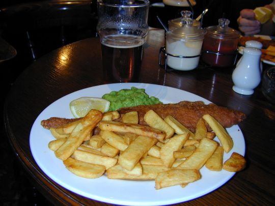 Brad gets fish and chips and peas.